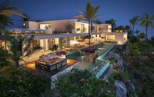 Luxury villa exterior by night